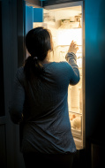 stock-photo-40169194-hungry-woman-looking-in-fridge-at-late-night